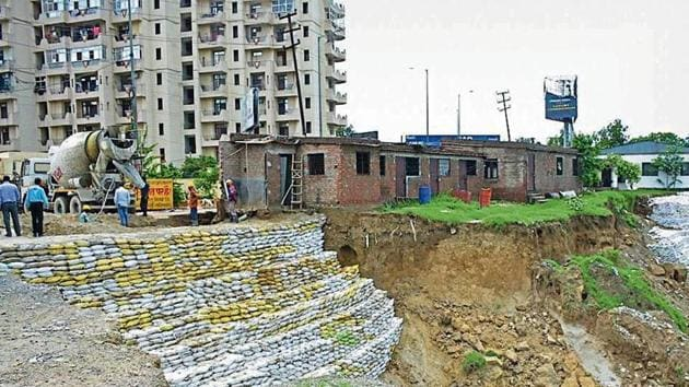 Ghaziabad development authority officials said the developer, on their directions, on Tuesday started putting up sand bags to plug the cave-in breach.