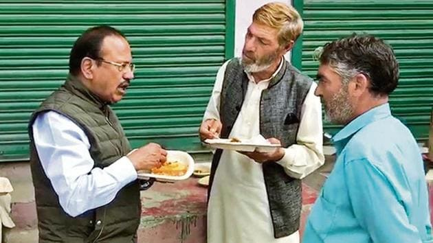 National Security Advisor Ajit Doval interacts with locals while reviewing the security situation in Shopian on Wednesday.(PTI Photo)