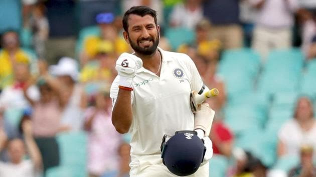 India's Cheteshwar Pujara celebrates his century (100 runs) during the first day of the fourth and final cricket Test against Australia at the Sydney Cricket Ground in Sydney.(AFP)