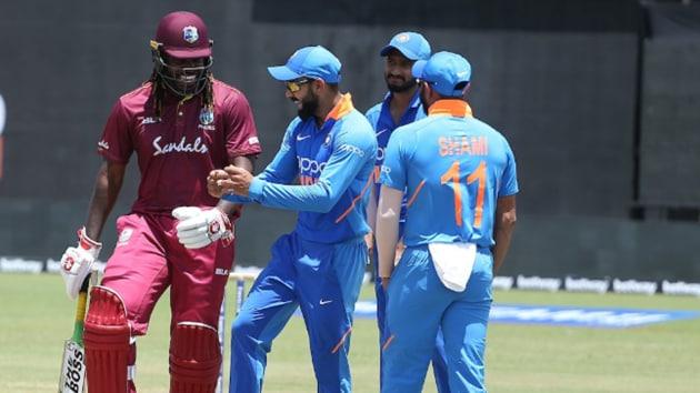 Virat Kohli breaks into a jig with Chris Gayle.(BCCI)