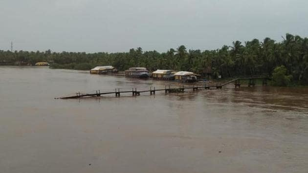 A bridge was swept away in gushing waters in north Kerala's Kasargode.(HT Photo)