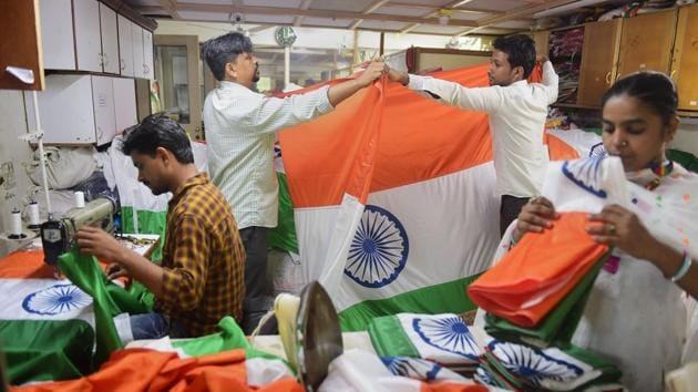 Workers prepare Indian flags at a workshop ahead of Independence Day, in Mumbai on Friday.(Photo: PTI)