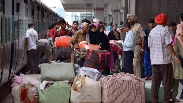 Punjab, Aug 08 (ANI): Indian and Pakistani passengers come out of the Samjhauta Express at Attari railway station in Amritsar on Thursday. (ANI Photo)