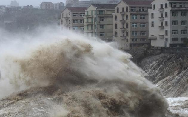 The NMC issued a red alert as the super typhoon approached on Friday, before downgrading the level to orange as the winds eased to 144 km/h on Saturday morning.(AP Photo)