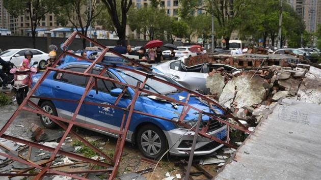 Cars are damaged after Typhoon Lekima made landfall in Wenling, Zhejiang province. More than a million people were evacuated from their homes ahead of the storm, the official Xinhua news agency reported. Some 110,000 people were housed in shelters. (REUTERS)