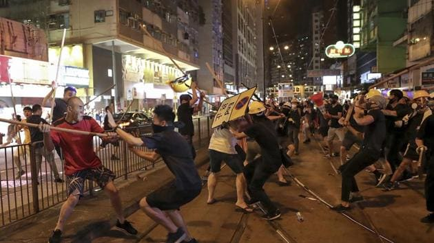 Some protesters blocked the streets for long hours and impeded traffic; some radical ones even stormed the Hong Kong Legislative Council building, destroyed public facilities, attacked the police with petrol bombs and damaged the national flag of China(AP)