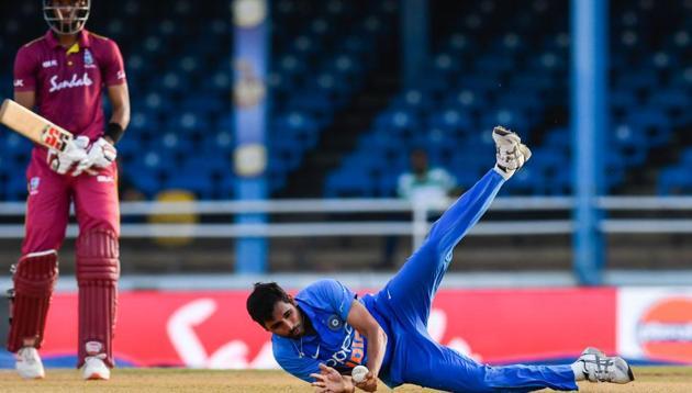 Bhuvneshwar Kumar (R) of India takes the catch to dismiss Roston Chase.(AFP)