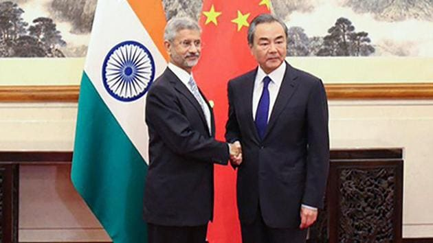 External Affairs Minister Subrahmanyam Jaishankar shakes hands with Chinese Foreign MinisterWang Yi during a meeting at Diaoyutai State Guesthouse, in Beijing, Monday, Aug 12, 2019.(PTI photo)
