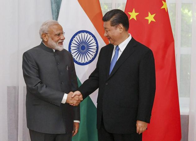 Prime Minister Narendra Modi with China's President Xi Jinping in Bishkek, Kyrgyzstan, June 13, 2019. The complex game of strategic hedging will come full circle when Modi meets Xi Jinping in October(PTI)