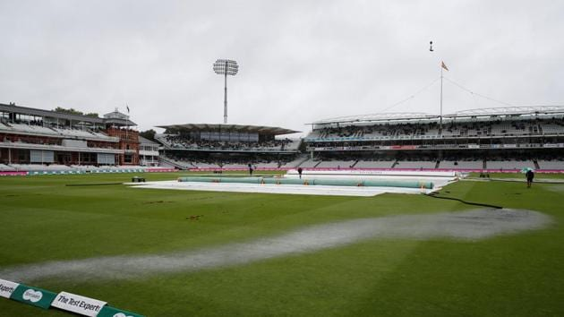 General view of covers on the field as rain delays play.(Action Images via Reuters)