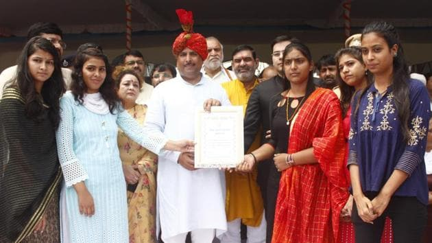 Finance minister of Haryana Captain Abhimanyu felicitates an achiever during 73th Independence Day function, at Tau Devi Lal Stadium, in Gurugram, on Thursday, August 15, 2019.(Yogendra Kumar/HT PHOTO)