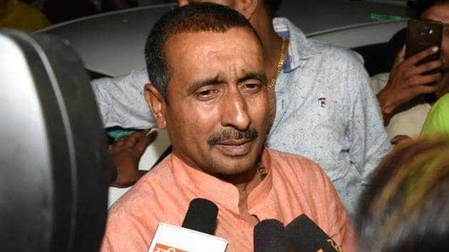 BJP MLA Kuldeep Singh Sengar, the main accused for allegedly raping a 17-year-old girl last year in Uttar Pradesh's Unnao, speaks to media personnel outside SSP office, in Lucknow.(Subhankar Chakraborty/HT PHOTO)
