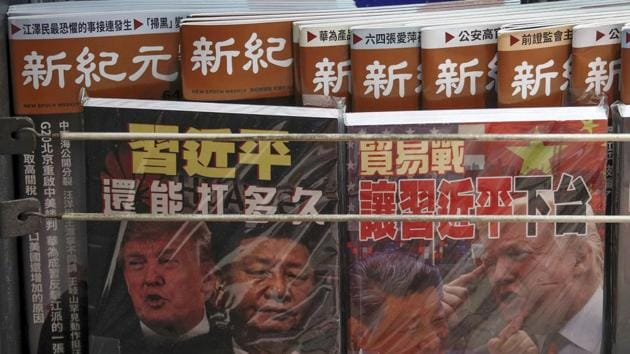 FILE - In this July 4, 2019, photo, Chinese magazines with front covers featuring Chinese President Xi Jinping and U.S. President Donald Trump on trade war are placed for sale at a roadside bookstand in Hong Kong. China on Thursday, Aug. 15, 2019 threatened retaliation if Washington steps up their war over trade and technology by going ahead with planned Sept. 1 tariff hikes on additional Chinese imports. (AP Photo/Andy Wong, File)(AP)