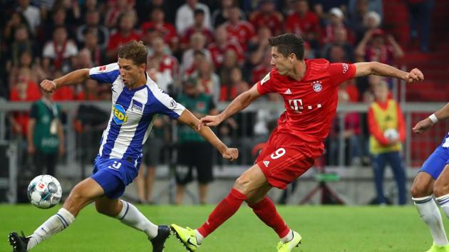 Soccer Football - Bundesliga - Bayern Munich v Hertha BSC - Allianz Arena, Munich, Germany - August 16, 2019 Bayern Munich's Robert Lewandowski shoots at goal(REUTERS)