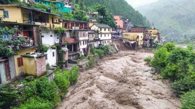 Flood water gush down after a cloudburst in Chamoli district, Monday, last week in Uttarakhand.(PTI)