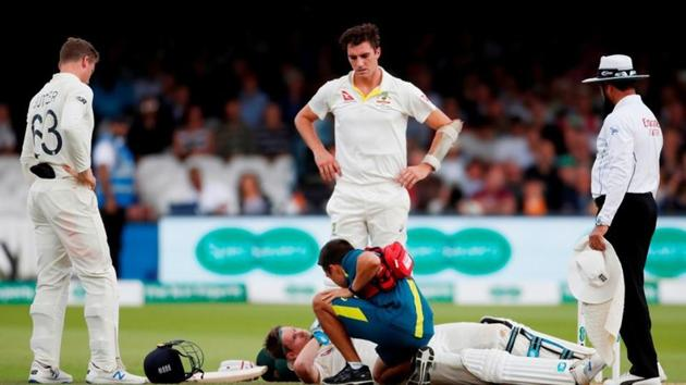 Australia's Steve Smith receives treatment as he lays on the floor after being hit by a ball from England's Jofra Archer(Action Images via Reuters)