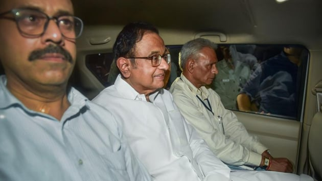 Officers of the CBI, ED and Delhi Police reached Chidambaram's home again soon after his press conference ended at Congress headquarters. When no one responded to officers thumping at the gates for a few minutes, one officer scaled the wall to open it for the rest. (PTI photo)