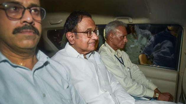At around 9.45pm, Chidambaram was hustled out of his house, bundled into a car – he sat in the middle on the rear seat of an Innova, between two CBI officials -- and driven away. (PTI photo)