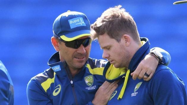 Australia coach Justin Langer, centre left, and Steve Smith, center right, during a nets session at Headingley.(AP)