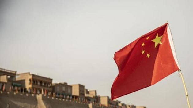 A Chinese flag flies outside the east gate of the Old City in Kashgar, Xinjiang. Image used for representational purpose only.(Photo: Bloomberg)