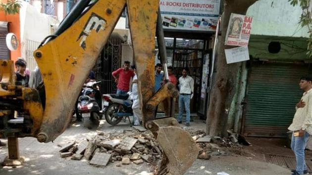 At least 15 old cars and two-wheelers illegally parked along the road were impounded. There were multiple shops along the road which, over the years, had built extensions on the footpath, some of which even touched the road.(SOURCED)