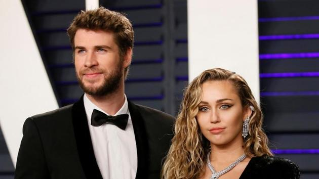 Liam Hemsworth and Miley Cyrus in happier days.(REUTERS)