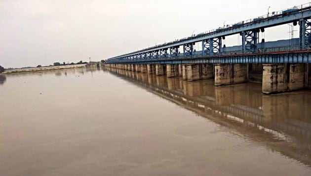 The water level of Ganga river reaches at the warning point in Kanpur on Friday.(ANI photo)