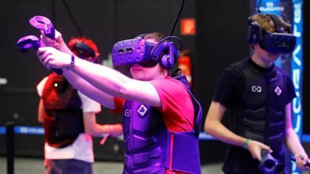 A gamer wears augmented reality goggles to play a shooting game during Europe's leading digital games fair Gamescom, which showcases the latest trends of the computer gaming scene in Cologne, Germany, August 21, 2019. REUTERS/Wolfgang Rattay(REUTERS)