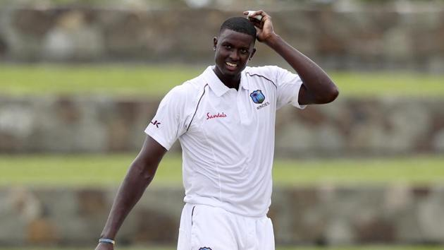 West Indies' captain Jason Holder scratches his head during day one of the first Test cricket match against India at the Sir Vivian Richards cricket ground in North Sound, Antigua and Barbuda, Thursday, Aug. 22, 2019.(AP)