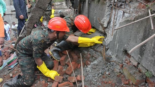 Rescuers search for survivors in the debris of a four storey building which collapsed on Saturday killing two persons and injuring five others.(Praful Gangurde/ HT Photo)