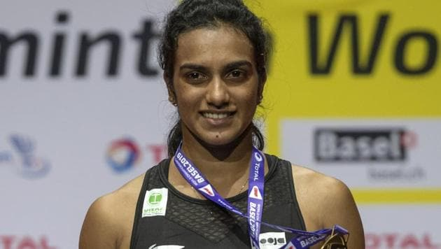 India's gold-medallist Pusarla V. Sindhu after winning her women's singles final match against Japan's Nozomi Okuhara at the BWF Badminton World Championships in Basel, Switzerland(AP)