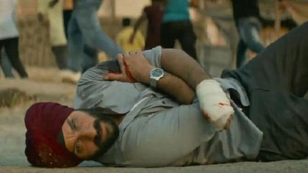 Saif Ali Khan as Sartaj Singh in a scene from Sacred Games, as he looks on helplessly while a young man gets lynched by a mob.