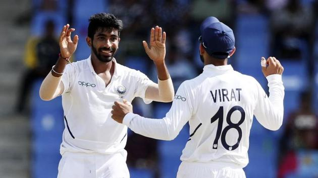 India's Jasprit Bumrah celebrates with team captain Virat Kohli the dismissal of West Indies' Darren Bravo during day two of the first Test cricket match at the Sir Vivian Richards cricket ground in North Sound, Antigua and Barbuda.(AP)