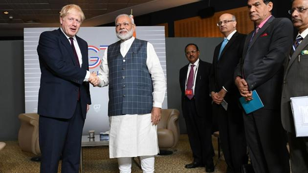 Britain's Prime Minister Boris Johnson meets Indian Prime Minister Narendra Modi at a bilateral meeting during the G7 summit in Biarritz, France August 25, 2019(REUTERS)