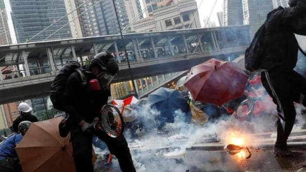 Demonstrators protect themselves from tear gas canisters during a protest in Tsuen Wan, Hong Kong .(Reuters Photo)
