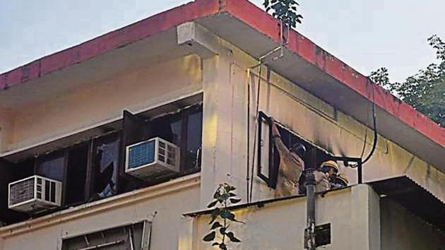 Firefighters try to douse the fire that broke out inside the office of Delhi Commission for Women, at Vikas Bhawan, ITO, in New Delhi on Tuesday, August 27, 2019. (Photo by Sanchit Khanna/ Hindustan Times)