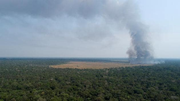 An aerial view shows smoke rising over a deforested plot of the Amazon jungle in Porto Velho, Rondonia State, Brazil.(REUTERS)