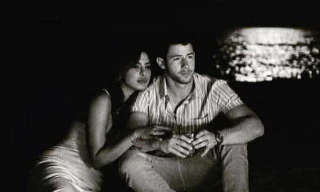 Priyanka Chopra and Nick Jonas sit quietly together in a new photo.