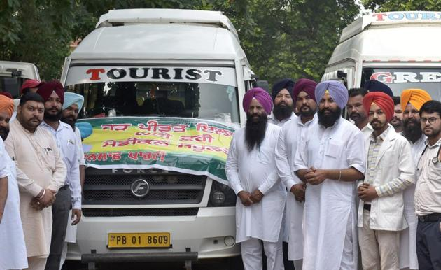 Lok Insaaf Party MLA Simarjeet Singh Bains and his supporters flagging off the relief material for flood victims in Ludhiana on Friday.(HT Photo)