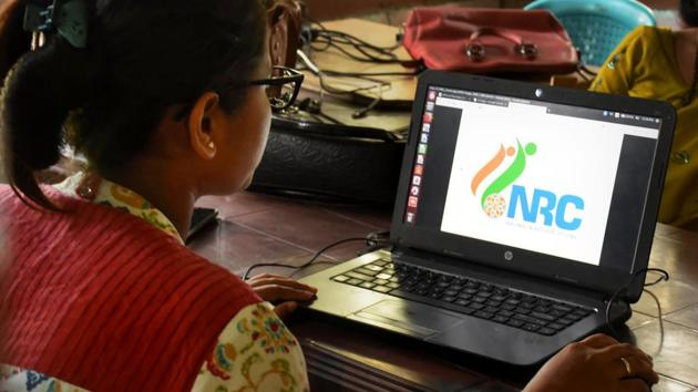 An official checks the documents submitted by people at an National Register of Citizens (NRC) Seva Kendra in Guwahati, Friday, Aug 30, 2019.(PTI)
