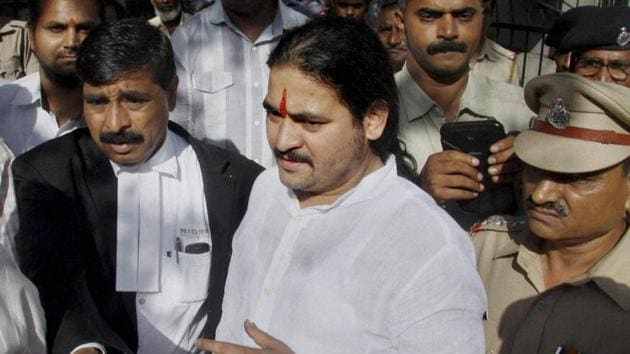 President of Hindu Rashtra Sena (HRS) Dhananjay Desai being produced at a Pune court on Wednesday.(PTI Photo)