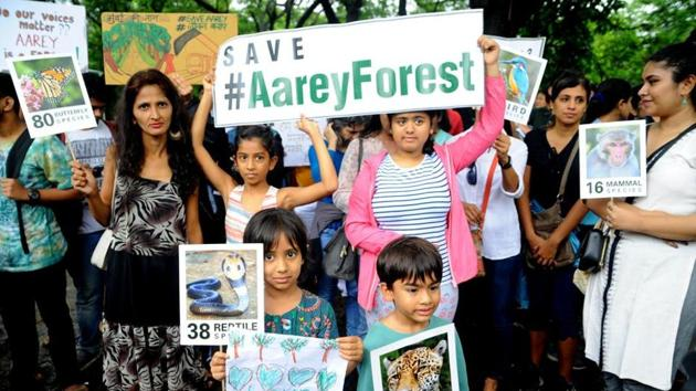 Citizens hold a protest march at Aarey Milk Colony on Saturday against the decision to cut trees for the Metro-3 project.(HT Photo)