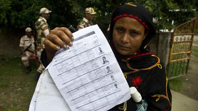 A woman displays a document that shows inclusion of her name in the final list of the National Register of Citizens (NRC), Pabhokati village, Morigaon district, Assam(AP)