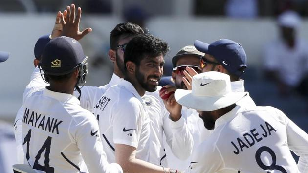 India's Jasprit Bumrah is greeted by teammates after taking a wicket.(AP)