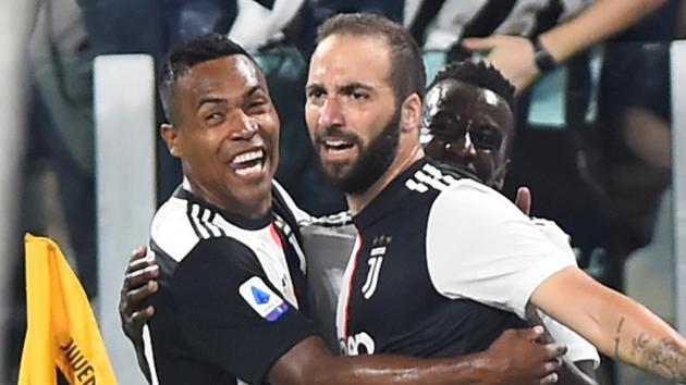 Juventus' Gonzalo Higuain celebrates scoring their second goal with Alex Sandro and Blaise Matuidi.(REUTERS)