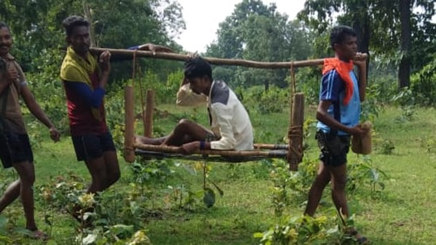 A police team in Chhattisgarh trekked 12 km through jungles to carry an injured Maoist commander to a hospital in Dantewada on Sunday, a top police official said.
