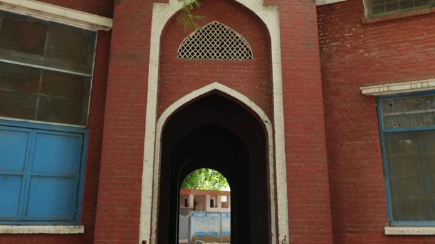 A witness to the city's colonial past, the Government Boys' Senior Secondary School shares its boundary wall with the Civil Hospital. Until recently, it faced the prospect of being partly demolished to expand the hospital next door.(Parveen Kumar/HT Photo)