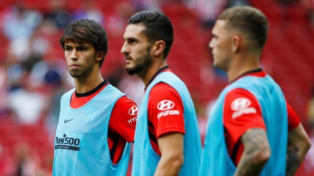 Atletico Madrid's Joao Felix, Koke and Kieran Trippier during the warm up.(REUTERS)