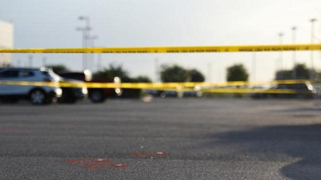 Police tape and evidences are seen as Texas state troopers and other emergency personnel monitor the scene at a local car dealership following a shooting in Odessa, Texas, US on September 1, 2019.(Reuters File Photo)