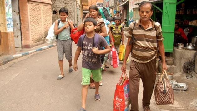 Residents of Bowbazar in central Kolkata evacuating their houses after they developed cracks,(Sourced)